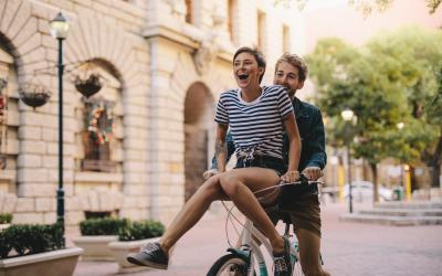 Happy young couple on a bike