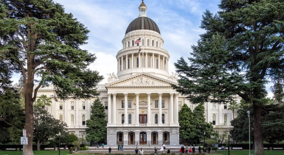 front view of the california state capitol flanked by trees