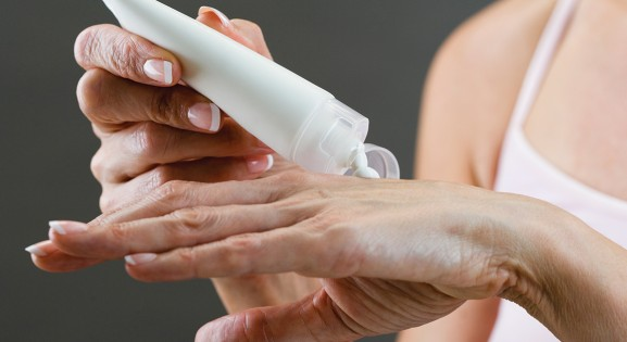 person applying lotion to hands
