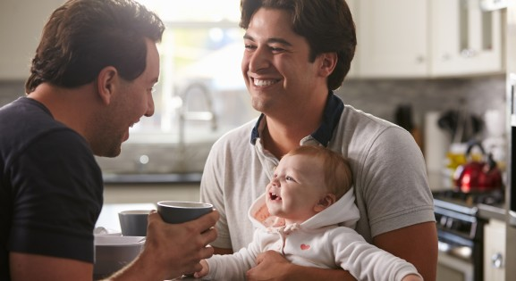 Same Sex Couple with Their Baby in the kitchen