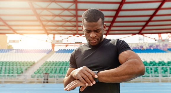 Athlete Outside with Fitness Tracker on a running track